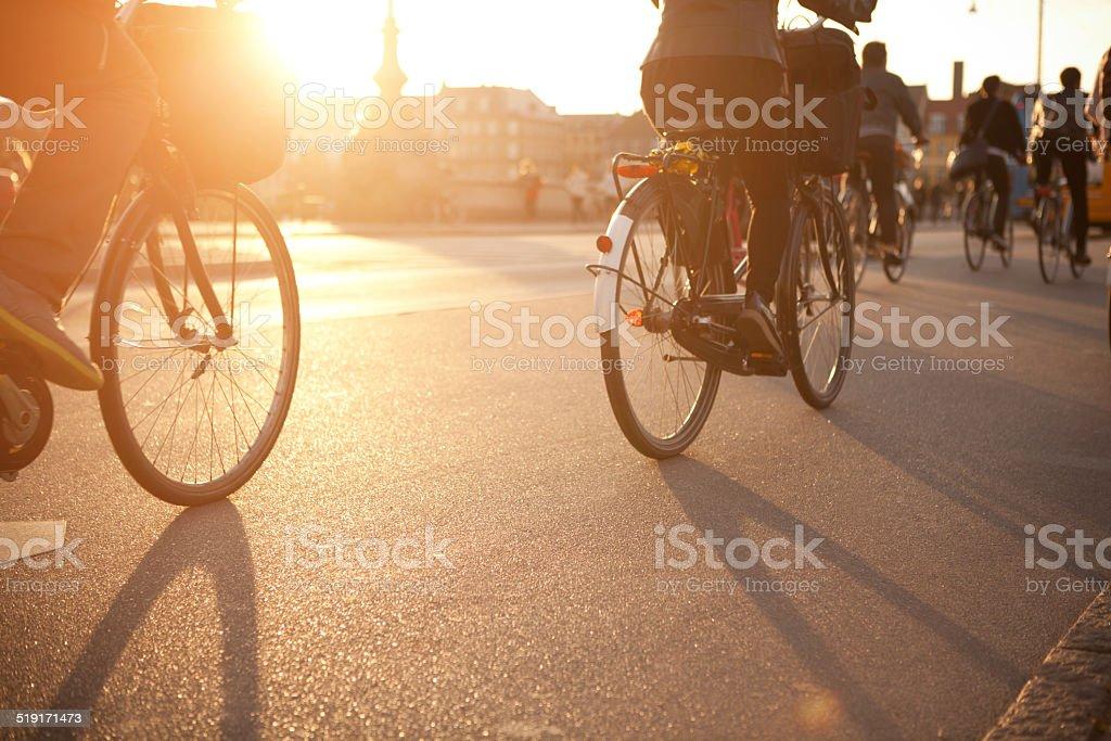 Cycling on city street. stock photo