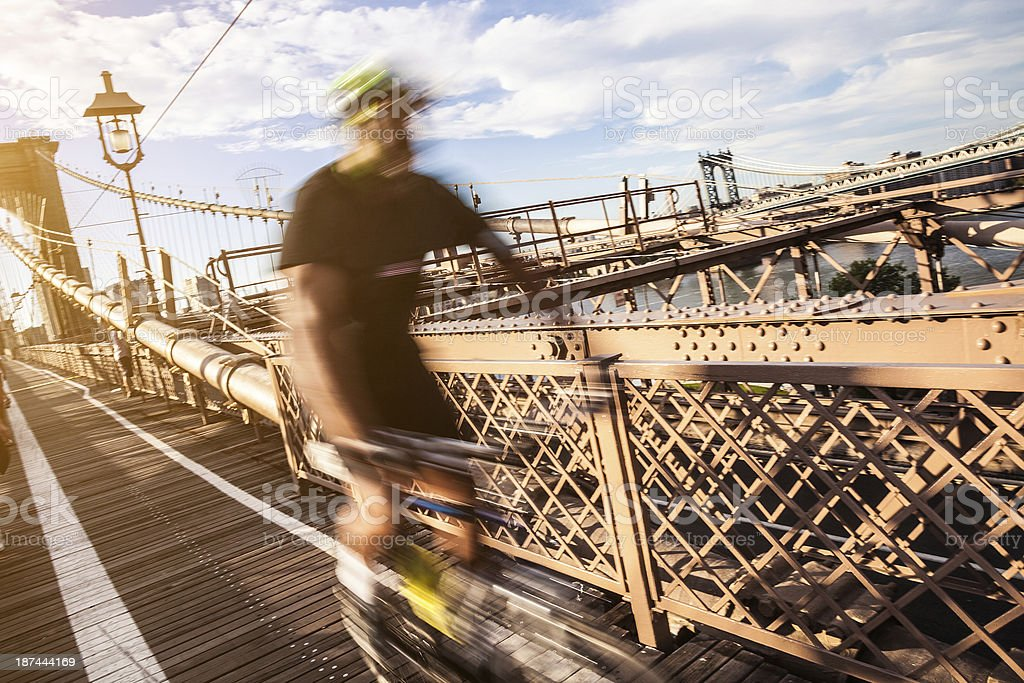 Cycling on the Brooklyn Bridge royalty-free stock photo