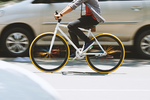 Man riding on bicycle on the road, blurred motion