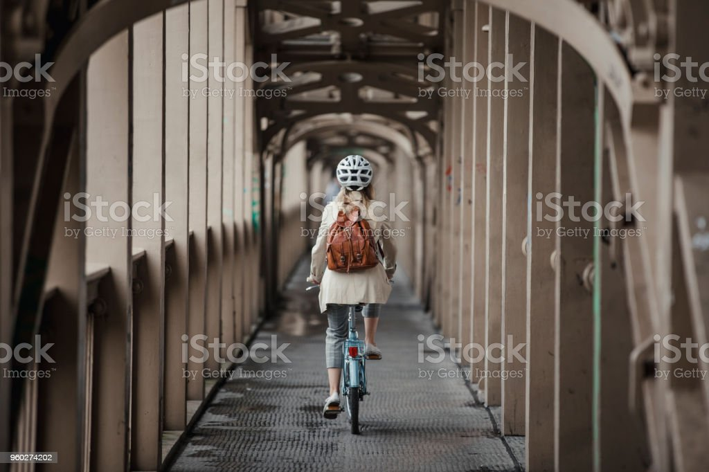 Cycling Over a Bridge to Work stock photo