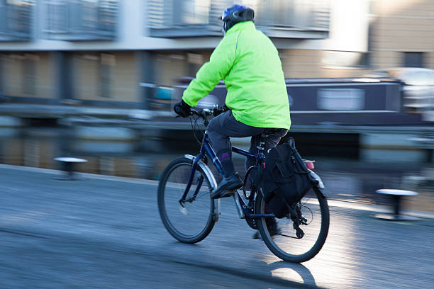 Cycling A person cycling down a cannal walkway reflective clothing stock pictures, royalty-free photos & images