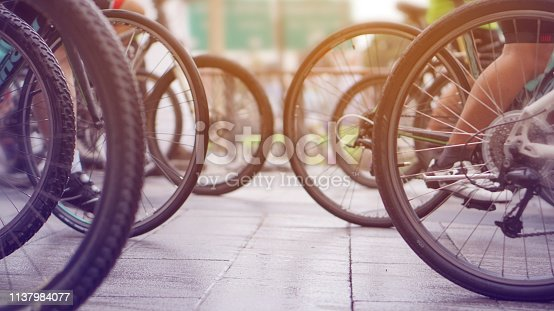 istock cycling race, car free green day biking abstract 1137984077