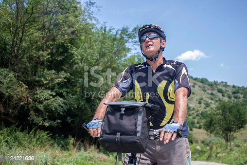 518659854istockphoto Cycling. Senior man on his mountain bike outdoors 1124221636