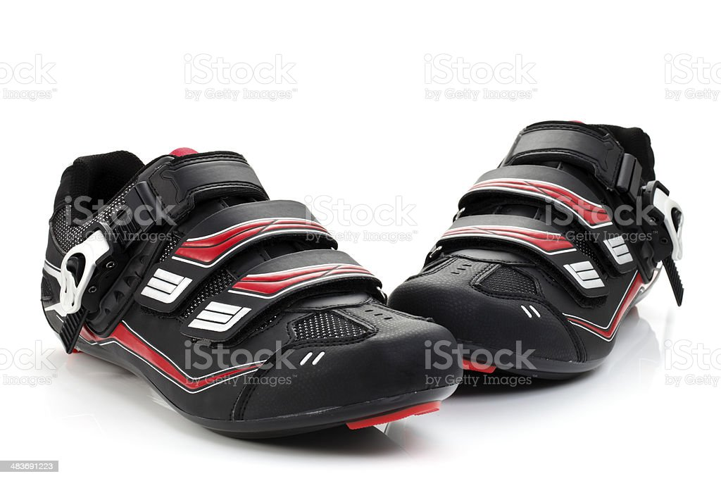Cycling shoes on white background. stock photo