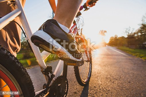 cycling outdoors, close up of the feet on pedal