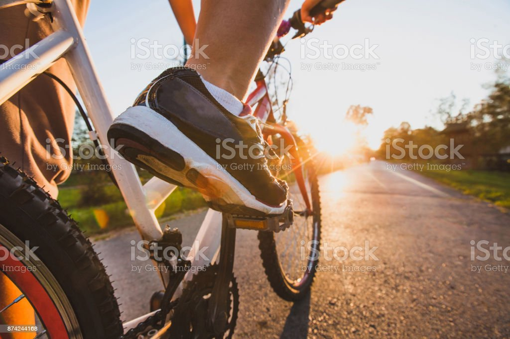 cycling sport, feet on pedal of bike stock photo