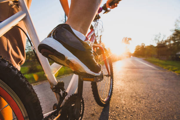 cycling sport, feet on pedal of bike - cycling stock photos and pictures
