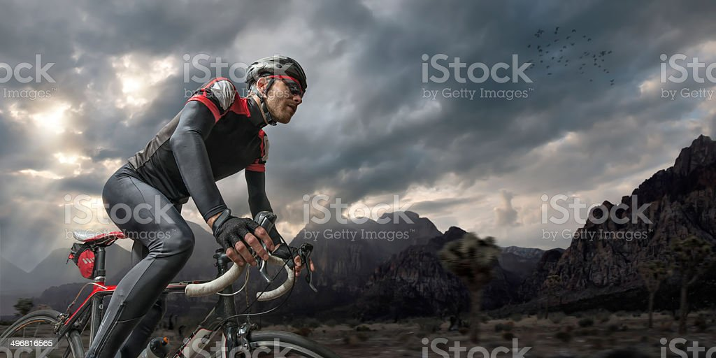 Cycling Through Mountains stock photo