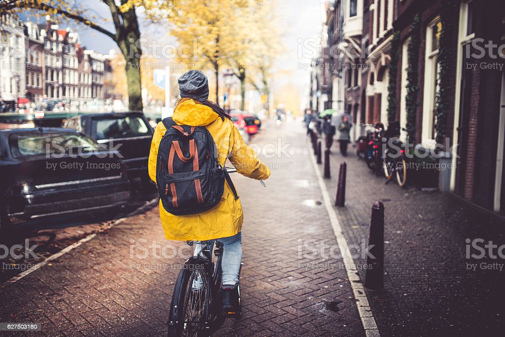 Cycling through the amsterdam stock photo