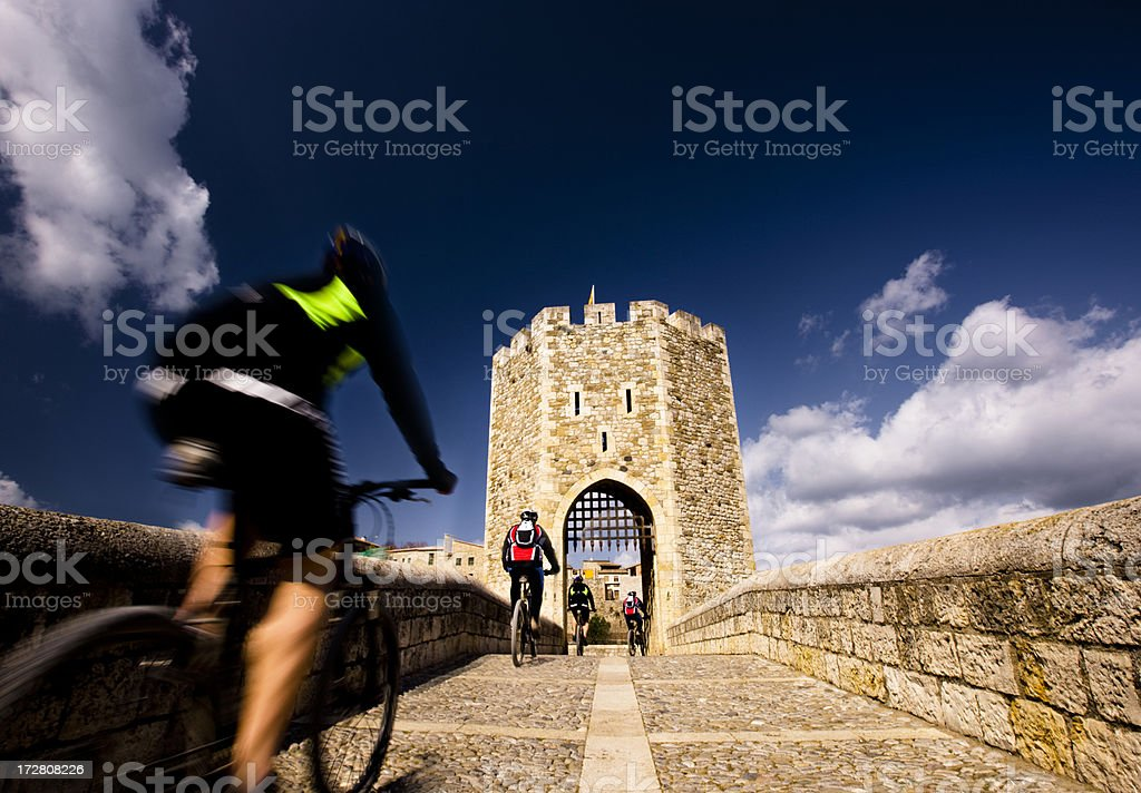 Cycling through the bridge. Popular cycling in Garrotxa. Adventure Stock Photo