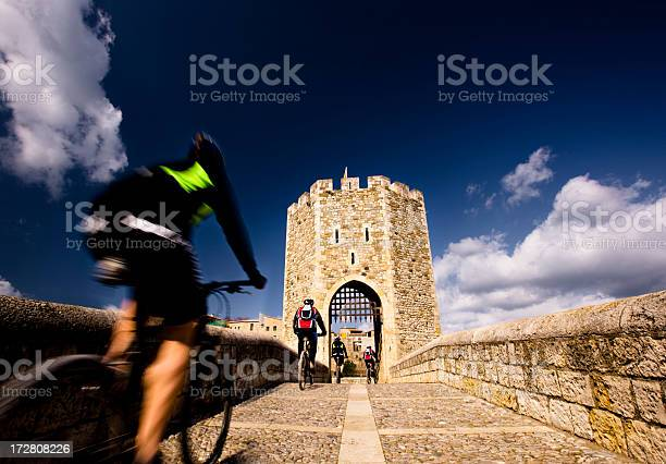 Cycling Through The Bridge Stock Photo - Download Image Now