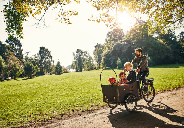 cycling through the park - denmark stock photos and pictures
