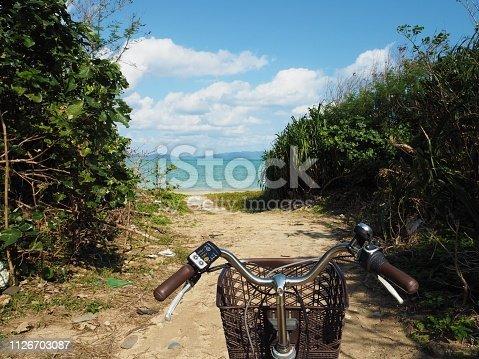 969439086 istock photo Cycling to the beach. Kohama Island, Okinawa, Japan. 1126703087