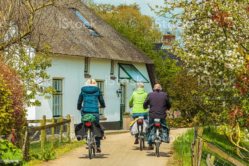Cycling tourists in the small Dutch village of Acquoy stock photo
