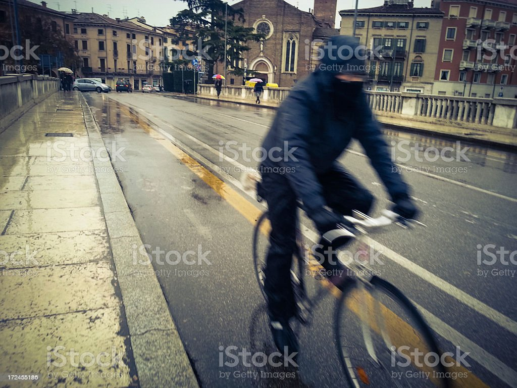 Cycling under the rain royalty-free stock photo