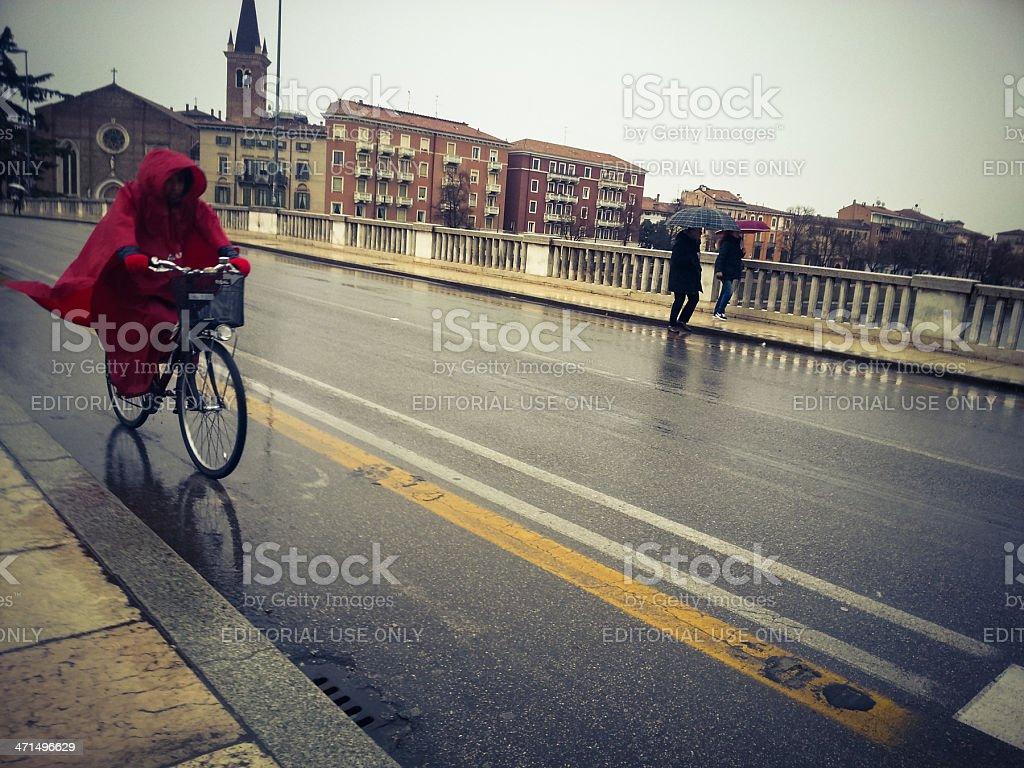 Cycling under the rain royalty-free stock photo