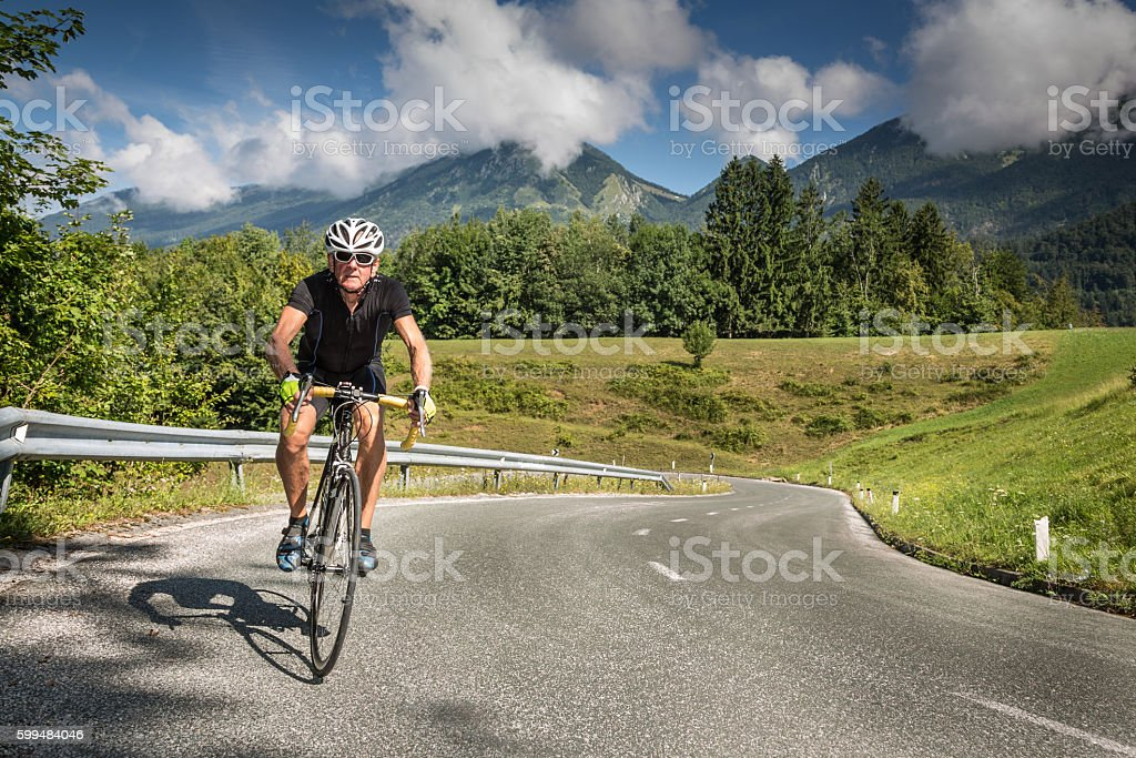 Cycling up the mountain stock photo