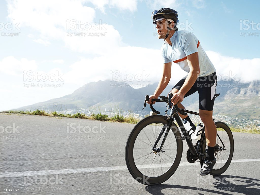 Cycling up this mountain is his Everest stock photo