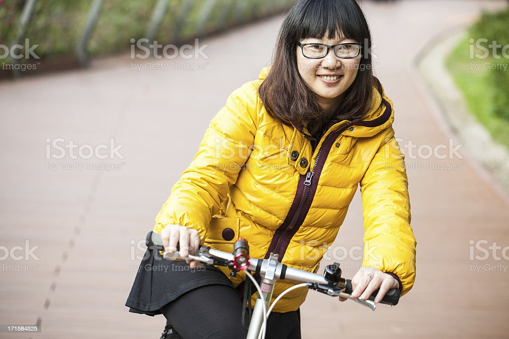 Cycling young Asian woman royalty-free stock photo