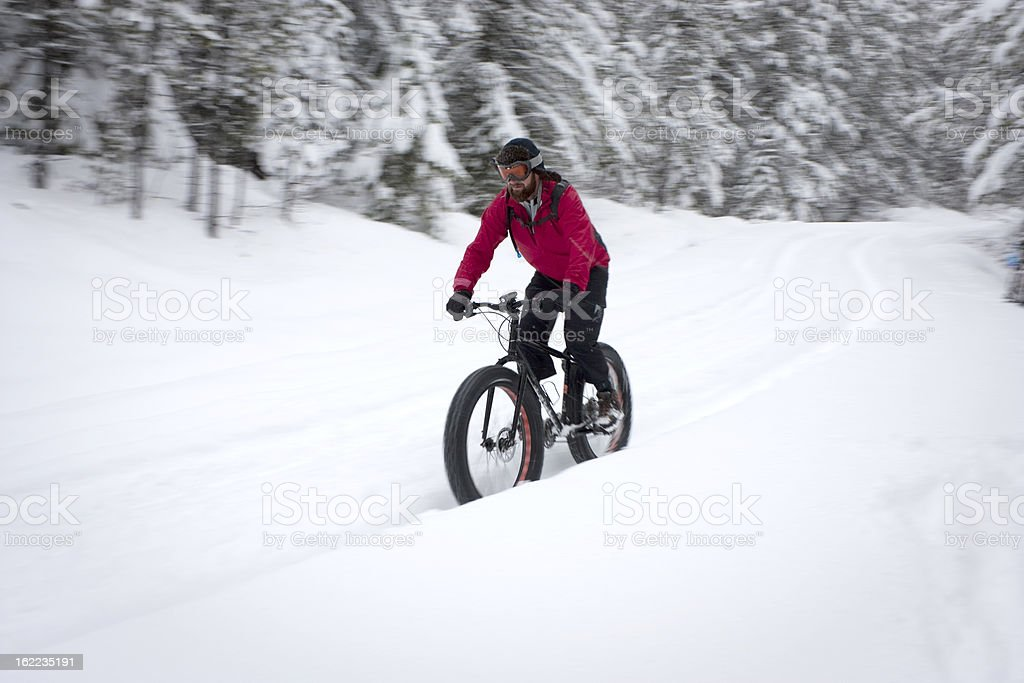 Cyclist at speed on a snow bike. royalty-free stock photo