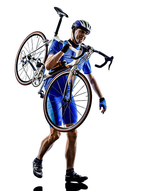 radfahrer fahrrad silhouette tragen - fahrradträger stock-fotos und bilder