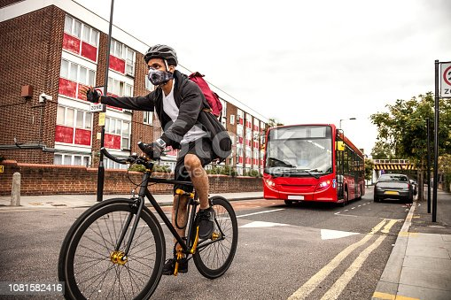 583973114istockphoto Cyclist commuter wearing a pollution-mask in Central London 1081582416