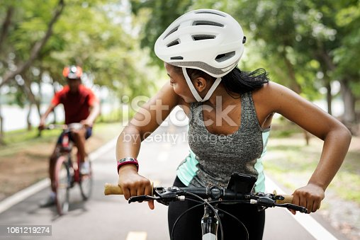 Cyclist couple riding bikes in a park