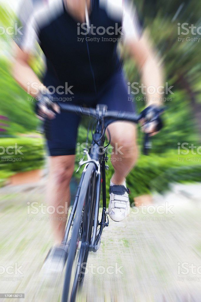 Cyclist in a Country Road royalty-free stock photo