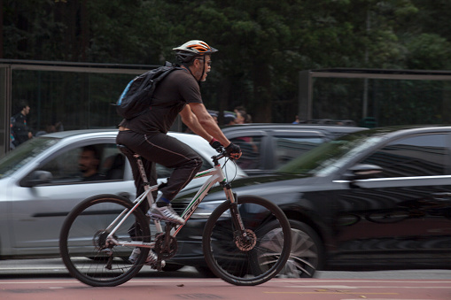 Sao Paulo, Brazil - September 3, 2016: Cyclist rides along the Paulista Avenue in Sao Paulo, which was determined leisure zone for the people on Sundays and holidays. the city mayor Fernando Haddad in June 2015.