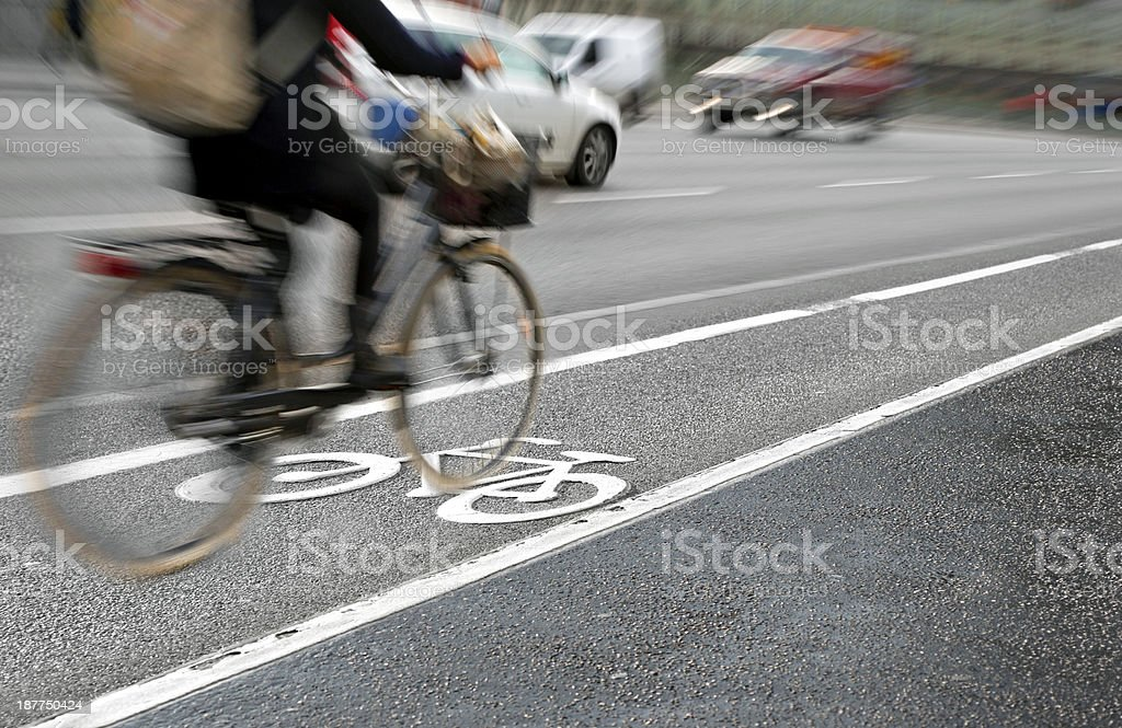 cyclist in bicycle lane stock photo