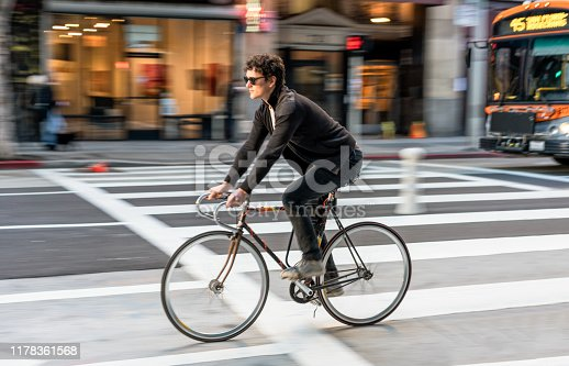 istock Cyclist in downtown Los Angeles 1178361568