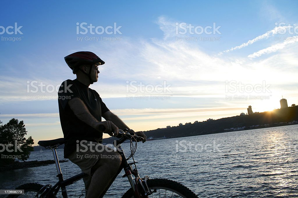Cyclist in front of Quebec city royalty-free stock photo