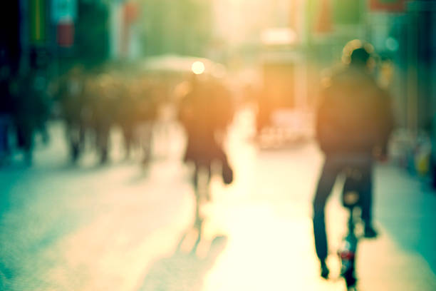 cyclist in the street, blurry - soft focus stock photos and pictures