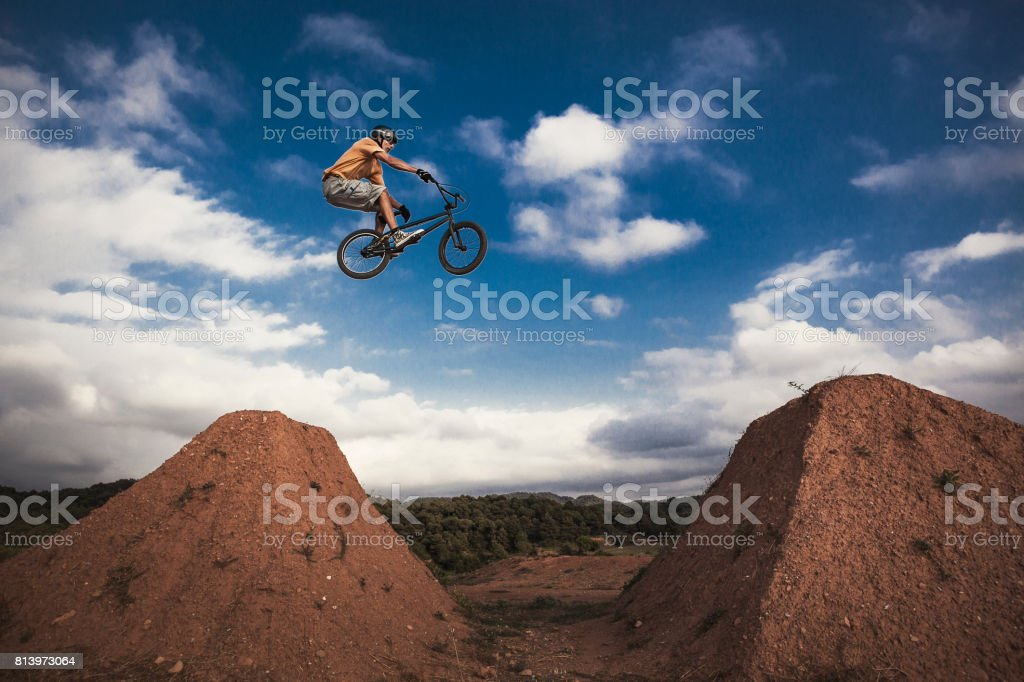 BMX cyclist jumping high. Real jump. stock photo