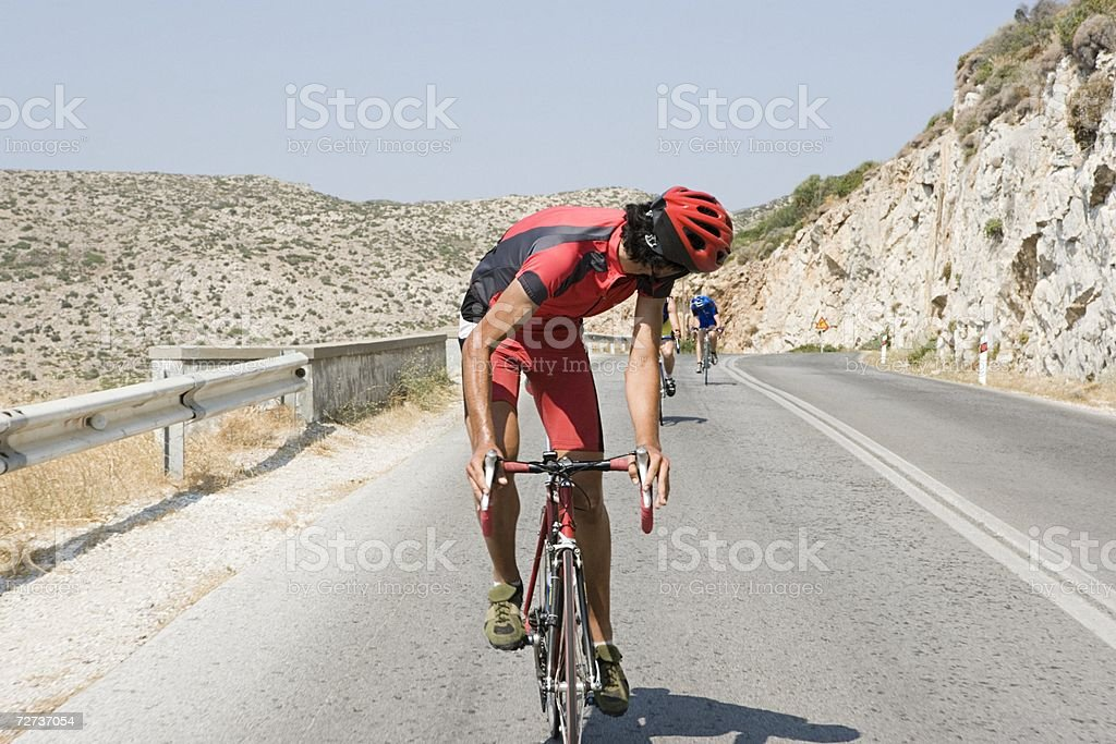 Cyclist looking over shoulder stock photo