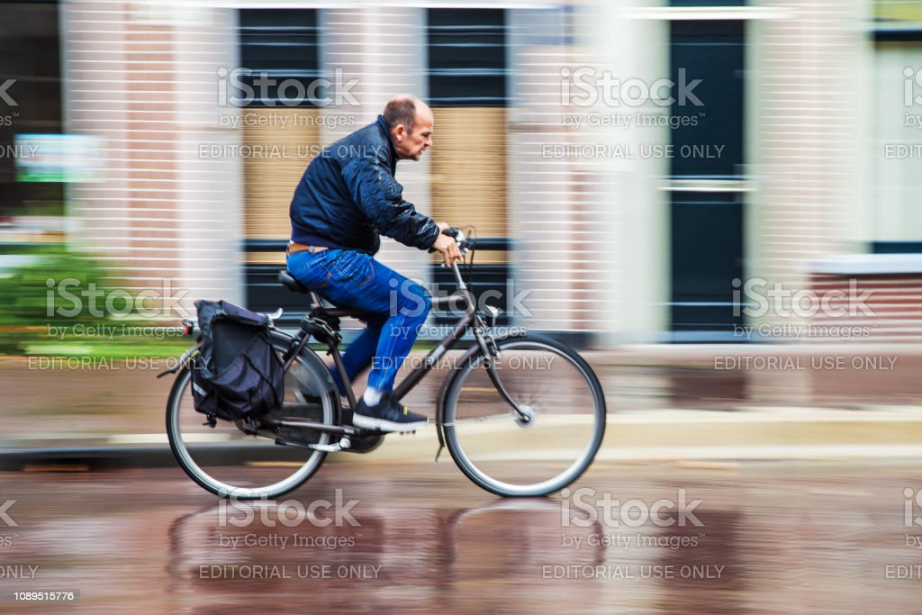 unidentified cyclist on a rainy day in motion blur. In NL almost as...