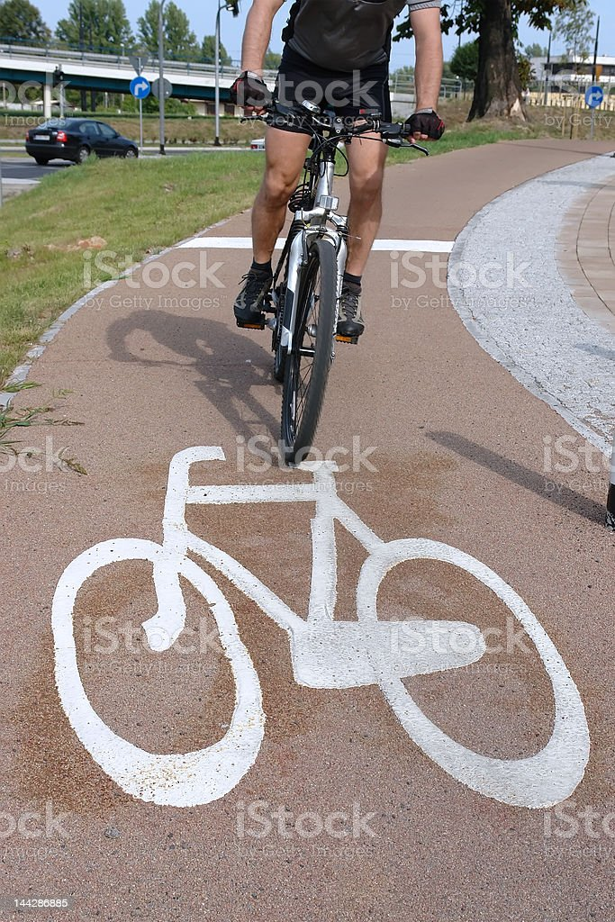 Cyclist on bike route royalty-free stock photo