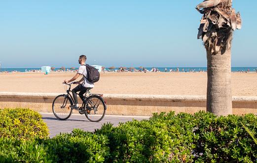 Cyclist on El Cabanyal in Valencia, Spain