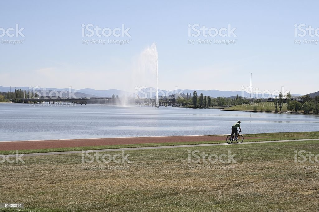 Cyclist on Lake Burley Griffin stock photo