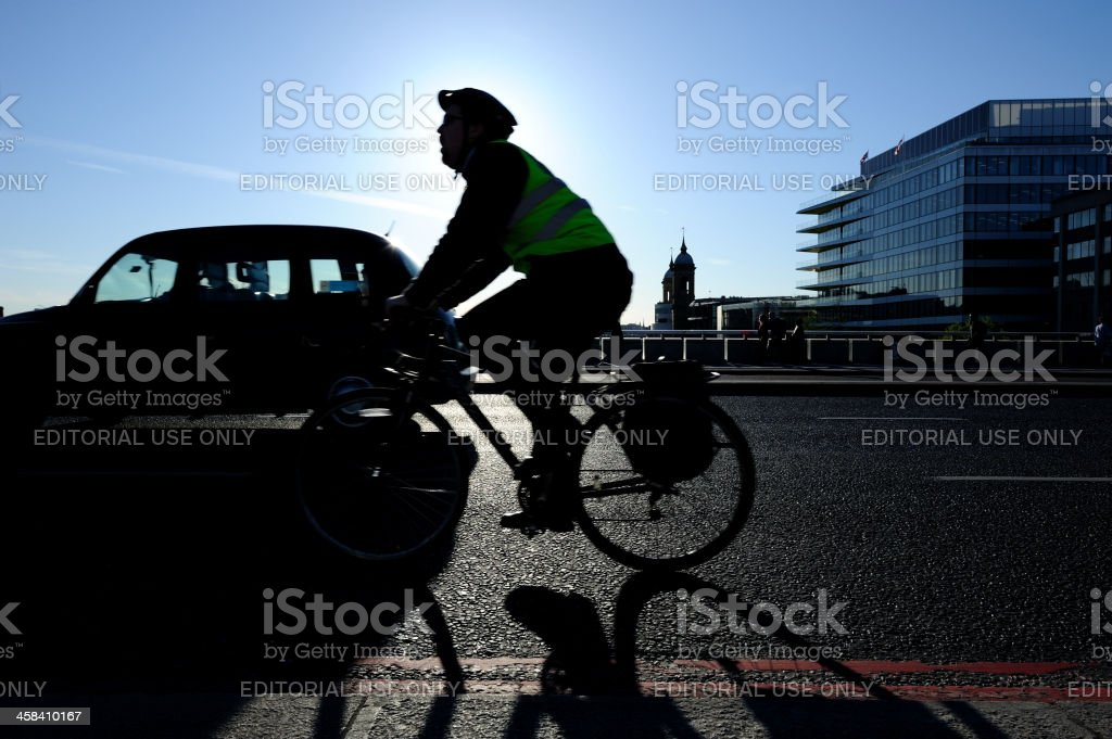 Cyclist on London Bridge royalty-free stock photo