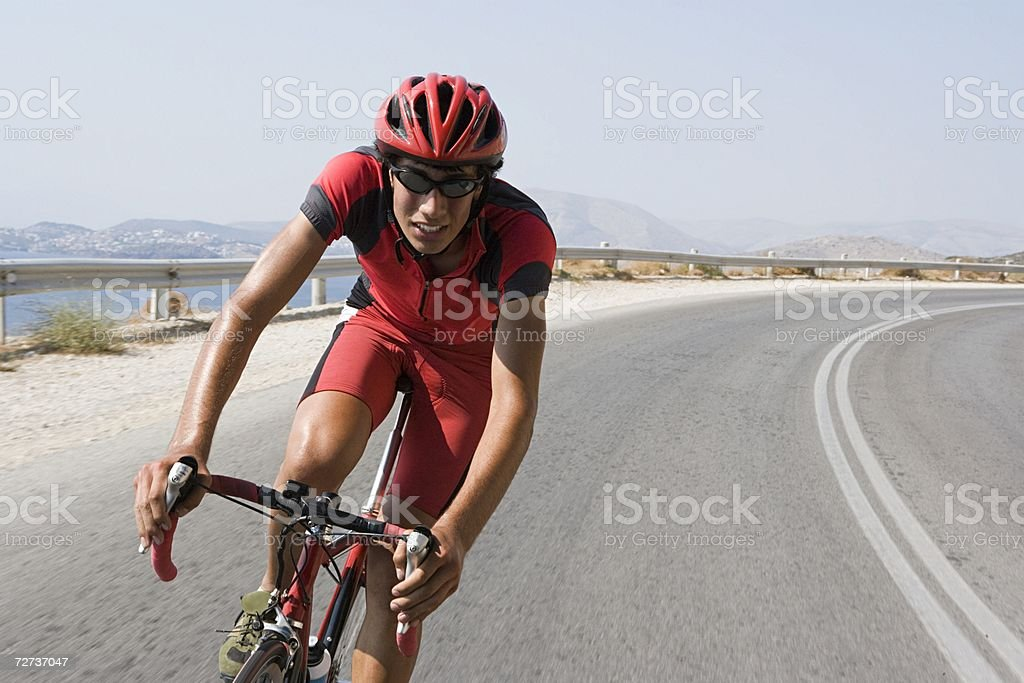Cyclist on road stock photo