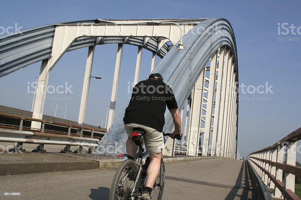 Cyclist on the bridge royalty-free stock photo
