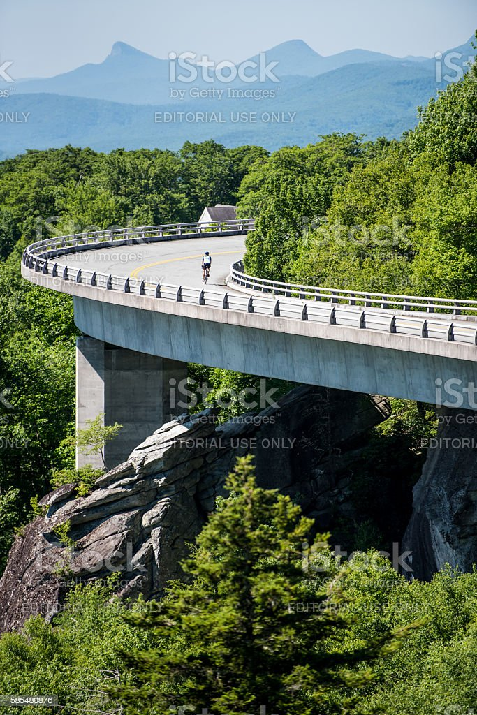Cyclist on the Linn Cove Viaduct in Summer stock photo