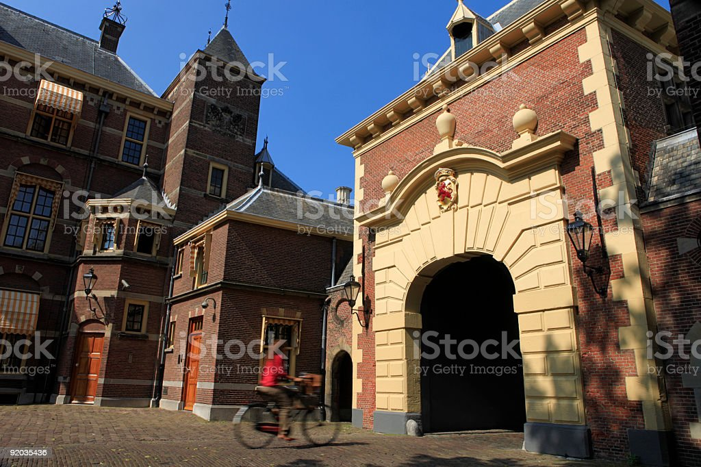 cyclist passing The Hague's Grenadiers' Gate at Binnenhof royalty-free stock photo