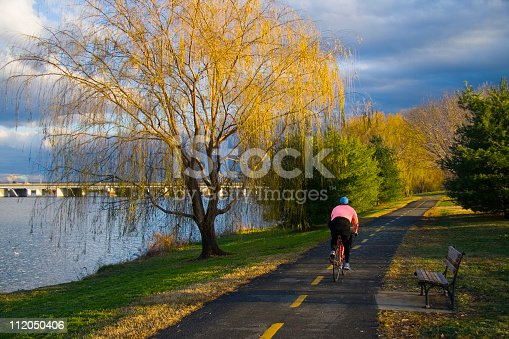 Cyclist on a bike path by the Potomac River in Washington, D.C.