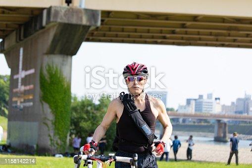 istock Cyclist pushing racing bike 1158142214