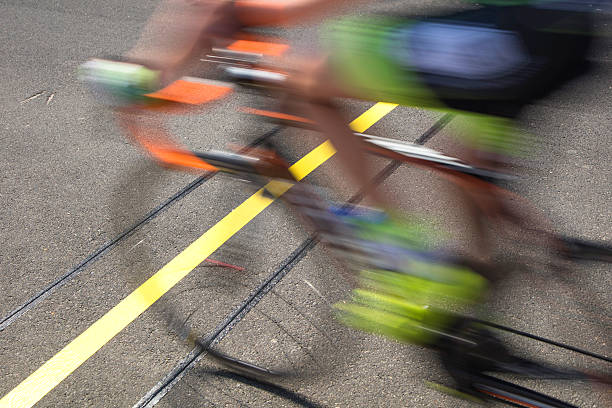 Cyclist reaching the goal line competing on a race stock photo