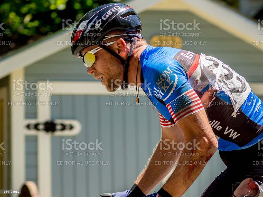 Cyclist rides after crashing in Nevada City Classic criterium stock photo