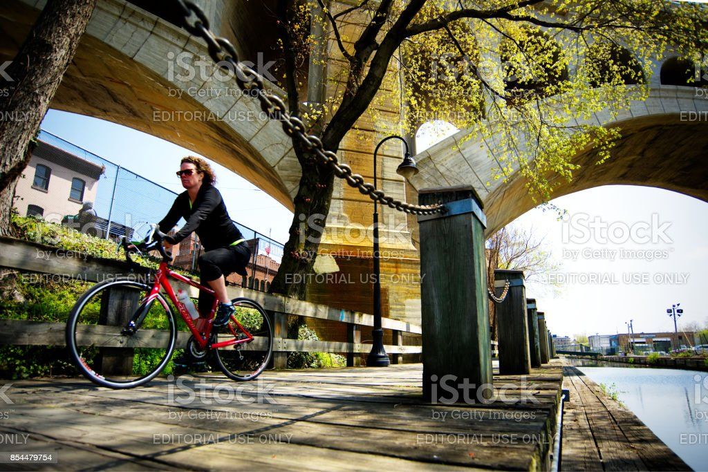 Cyclist Rides Towpath in Manayunk, Philadelphia stock photo