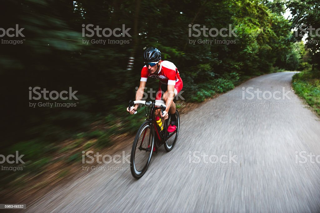 Cyclist riding a bicycle royalty-free stock photo